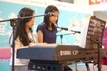 Yo Yo and Yan Yan playing piano four hands